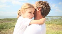 Portrait of cute little girl giving kiss to daddy Stock Footage