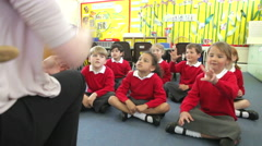 Stock Video Footage of Pupils Copying Teacher's Actions Whilst Singing Song