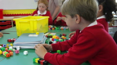 Pupils And Teacher Working With Coloured Blocks Stock Footage