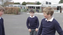Three Boys Fighting In School Playground Stock Footage