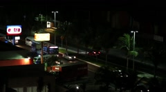 Mexico, Cancun - 11 March 2015: Caribbean street road with cars at  night Stock Footage