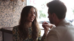 Happy couple at the coffee shop - stock footage