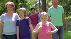 Multi-Generation Family Walking Along Woodland Path Together Stock Footage