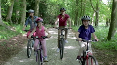 Family Riding Mountain Bikes Along Track Stock Footage
