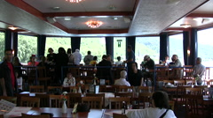 Passengers eating in a restaurant inside cruise boat on the Rhine river Stock Footage