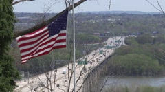 American Flag and Highway traffic on bridge.mp4 Stock Footage