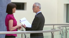 Two Consultants Meeting In Hospital Reception - stock footage