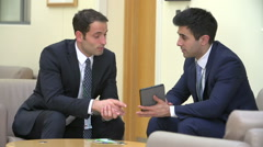 Two Doctors Discussing Patient Notes On Digital Tablet - stock footage