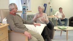 Nurse Checking On Senior Male Patient Having Chemotherapy Stock Footage