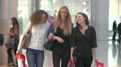 Three Female Friends Shopping In Mall Together - stock footage