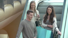 Group Of Young Friends Riding Escaltor In Shopping Mall Stock Footage