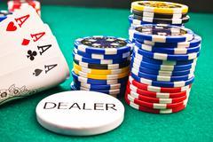 dealer  chips poker poker aces - stock photo