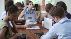 Group Of Office Workers Meeting To Discuss Ideas - stock footage