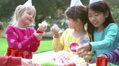 Group Of Children Having Outdoor Birthday Party - stock footage
