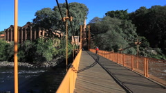 Beautiful old bridge. People walking over a bridge. Stock Footage
