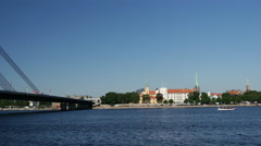 Riga Castle on the banks of River Daugava with the Vanšu Bridge in Riga Stock Footage