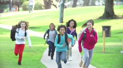 Children Running Towards Camera In Slow Motion Stock Footage