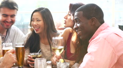 Group Of Friends Enjoying Drink At Outdoor Rooftop Bar Stock Footage