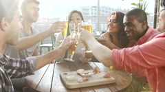 Group Of Friends Enjoying Drink And Snack In Rooftop Bar Stock Footage