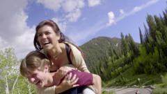 Cute Couples Have A Piggyback Ride Race Back To Their Car (Slow Motion) - stock footage
