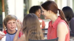 Family Enjoying Snack At Outdoor Cafe Stock Footage
