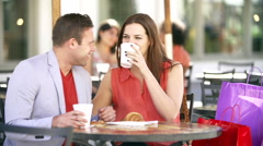 Couple Enjoying Snack In Cafe - stock footage