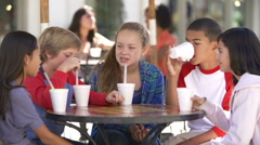 Group Of Children Hanging Out Together In Cafe Stock Footage