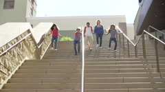Slow Motion Sequence Of Teenagers Running Down Stairs Arkistovideo