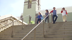 Slow Motion Sequence Of Teenagers Running Down Stairs Stock Footage