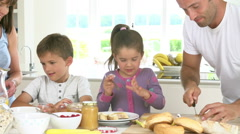 Family Making Breakfast In Kitchen Together Stock Footage