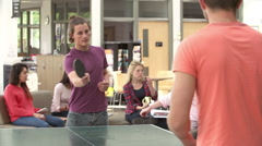 College Students Relaxing And Playing Table Tennis Stock Footage
