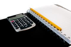 Calculator on a personal organizer Stock Photos