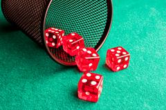 five red dice  near a container - stock photo