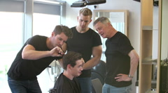 Teacher Training Mature Students In Male Hairdressing Class Stock Footage