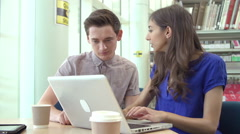 Two University Students Collaborating On Projects In Library Stock Footage