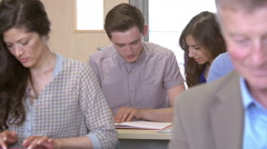 Mature Students Working In Further Education Class Stock Footage