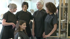 Teacher Training Mature Students In Hairdressing Class Stock Footage