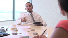 Four Businesspeople Having Meeting Around Boardroom Table Stock Footage