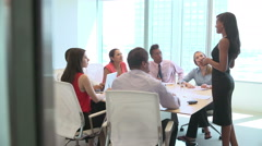 Seven Businesspeople Having Meeting Around Boardroom Table - stock footage