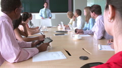 Group Of Businesspeople Meeting Around Boardroom Table Stock Footage