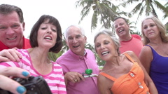Group Of Senior Friends Taking Selfie On Bicycle Ride Stock Footage
