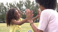 Mother And Daughter Playing Clapping Game In Park Together Stock Footage