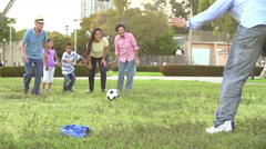 Slow Motion Shot Of Multi Generation Family Playing Soccer Stock Footage