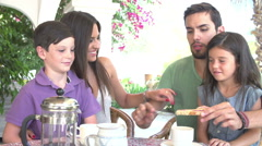 Family Eating Breakfast Outdoors Together Stock Footage