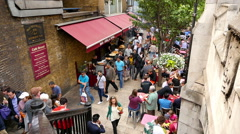 Time lapse of people walking around a restaurant, bar and pub in London city Stock Footage
