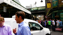 Time lapse of people walking around Borough Market in London city Stock Footage