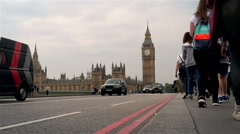 Time lapse of buses, cars and pedestrians crossing Westminster Bridge Stock Footage