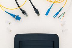 Above view of telecommunication connector with black router. - stock photo