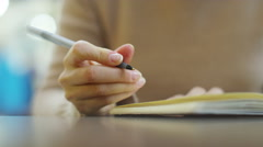 4k, Attractive, young woman writing in her diary at a train station Stock Footage