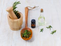 Natural Spa Ingredients  rosemary essential oil for aromatherapy. Stock Photos